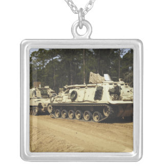 An M-88 recovery vehicle begins to tow an M992 Silver Plated Necklace