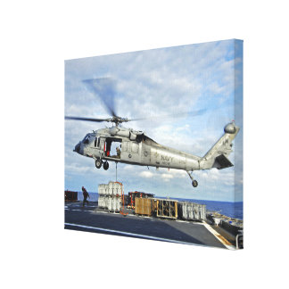 An MH-60S Seahawk prepares to deliver ammunitio Gallery Wrapped Canvas