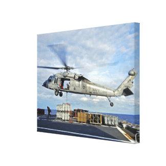 An MH-60S Seahawk prepares to deliver ammunitio Canvas Print
