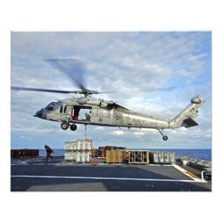 An MH-60S Seahawk prepares to deliver ammunitio Photo Print