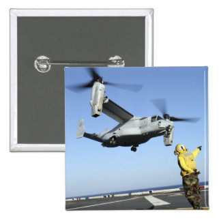 An MV-22 Osprey launches from the USS Nassau 2 Inch Square Button