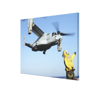 An MV-22 Osprey launches from the USS Nassau Canvas Print
