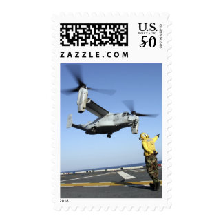 An MV-22 Osprey launches from the USS Nassau Postage