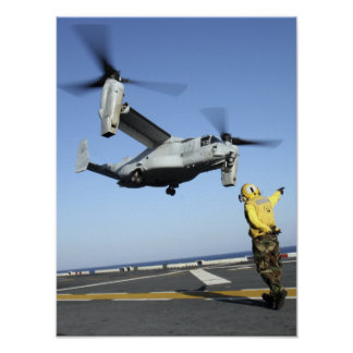 An MV-22 Osprey launches from the USS Nassau Poster