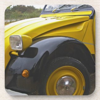 An old black and yellow Citroen 2CV 2 CV, Coaster