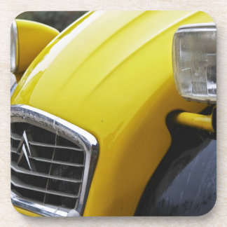 An old black and yellow Citroen 2CV 2 CV, detail Beverage Coasters