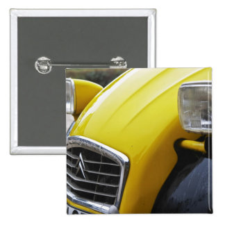 An old black and yellow Citroen 2CV 2 CV, detail Pinback Button