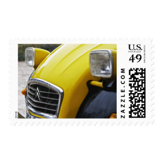 An old black and yellow Citroen 2CV 2 CV, detail Postage