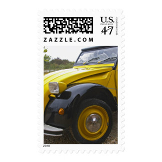 An old black and yellow Citroen 2CV 2 CV, Postage