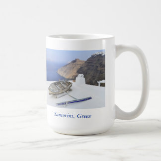 An old boat on the roof of a house in Santorini Coffee Mug