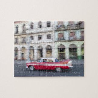 An old car cruising the streets of Havana, Cuba. Jigsaw Puzzle