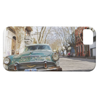 An old car rusty and flaky colour parked in the iPhone 5 cases