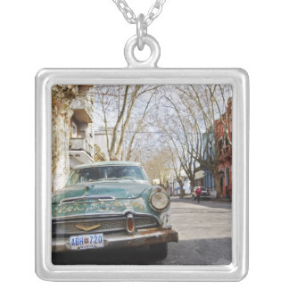 An old car rusty and flaky colour parked in the silver plated necklace