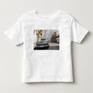 An old car rusty and flaky colour parked in the toddler t-shirt