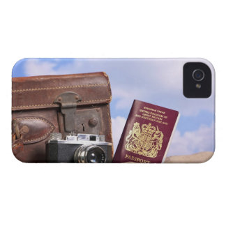 An old leather suitcase, retro camera and iPhone 4 case