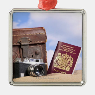 An old leather suitcase, retro camera and metal ornament