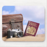An old leather suitcase, retro camera and mouse pad