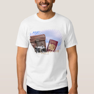 An old leather suitcase, retro camera and t shirt