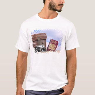 An old leather suitcase, retro camera and T-Shirt