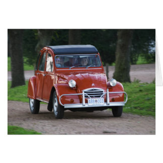 An old red Citroen 2CV car with a smiling woman Card
