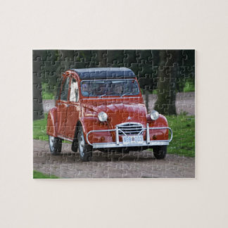 An old red Citroen 2CV car with a smiling woman Jigsaw Puzzle