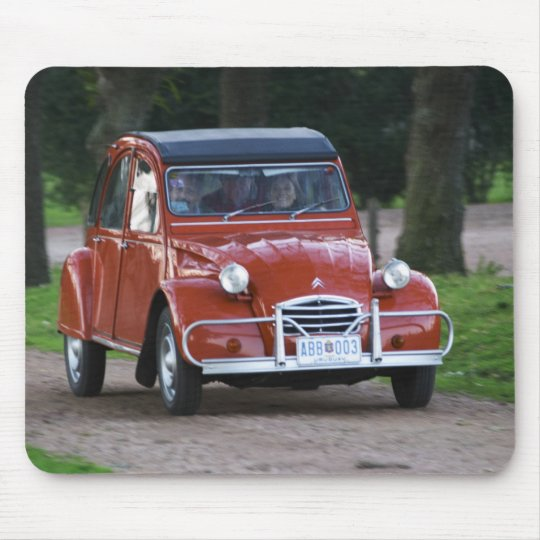 An old red Citroen 2CV car with a smiling woman Mouse Pad