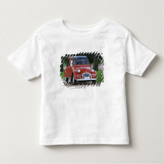 An old red Citroen 2CV car with a smiling woman Toddler T-shirt