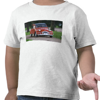 An old red Citroen 2CV car with a smiling woman T Shirts