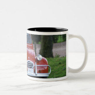 An old red Citroen 2CV car with a smiling woman Two-Tone Coffee Mug