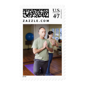 An older man in front of a younger woman postage stamp