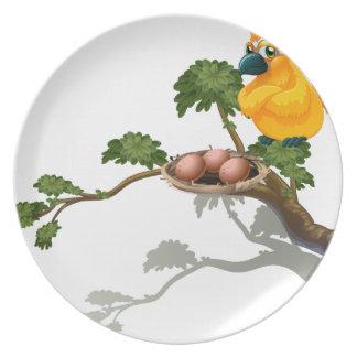 An orange bird watching the eggs plates