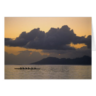 An outrigger canoe team practices off the coast card