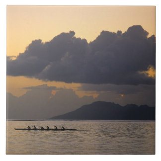 An outrigger canoe team practices off the coast ceramic tile
