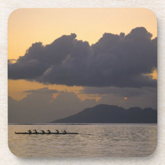 An outrigger canoe team practices off the coast beverage coaster