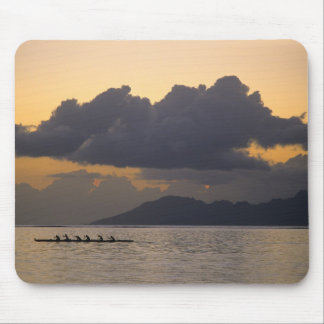 An outrigger canoe team practices off the coast mouse pad