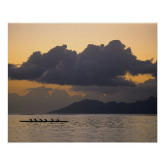 An outrigger canoe team practices off the coast poster