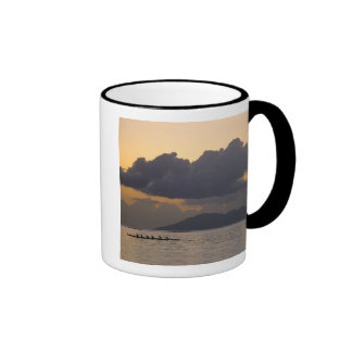 An outrigger canoe team practices off the coast ringer mug