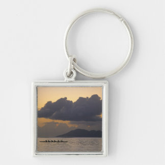 An outrigger canoe team practices off the coast Silver-Colored square keychain