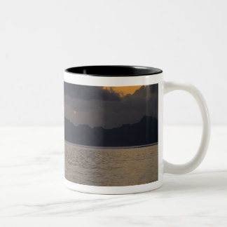 An outrigger canoe team practices off the coast Two-Tone coffee mug