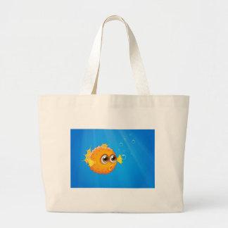 An ugly puffer fish in the ocean jumbo tote bag