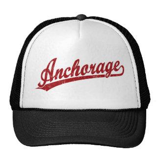 Anchorage script logo in red trucker hat