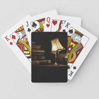 Ancient books, lamp shade and jug playing cards