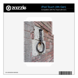 Ancient iron hoop hanging on stone wall iPod touch 4G skin