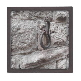 Ancient iron hoop hanging on stone wall keepsake box
