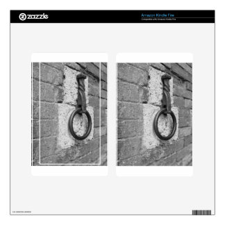Ancient iron hoop hanging on stone wall kindle fire decals
