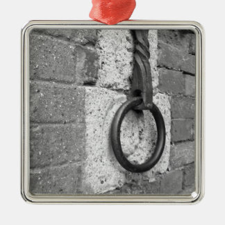 Ancient iron hoop hanging on stone wall metal ornament