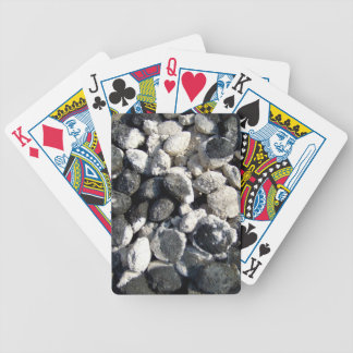 Ancient mud bowl with black and white material bicycle playing cards