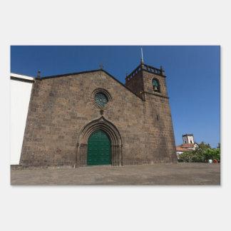 Ancient portuguese catholic church lawn sign