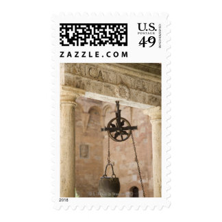 ancient public water well postage stamp