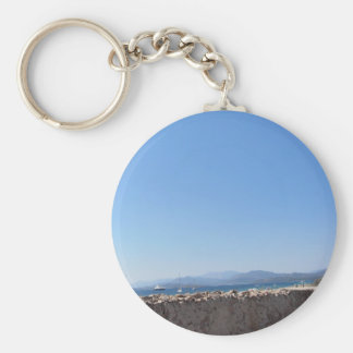 Ancient wall and windmill with seascape keychain